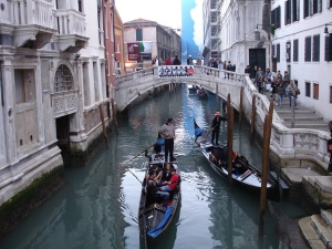Canal with gondola in Venice Italy