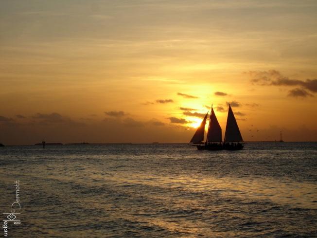 Orange sunset sailboat mcm